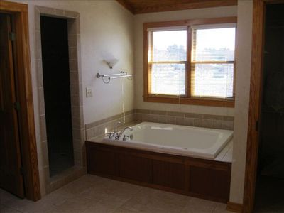 Large jetted tub with great water view in master bath