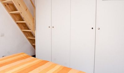 Detail of the closet and double bed behind. Up the stairs there are 2 beds