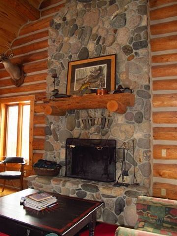 Custom built river rock fireplace in main living area, main floor