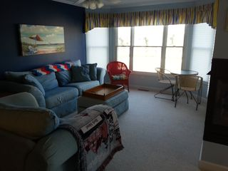 Manistee condo photo - Open living room with great views, 2 sided fireplace