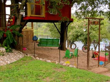 SECURE FENCED AREA FOR KIDS to play while you relax on the porch