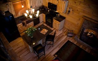 Stanardsville cabin photo - Well equipped kitchen, handmade cabinets, granite, island with bar stools.
