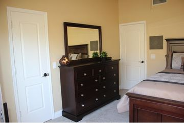 Chest of drawers and walk in closet