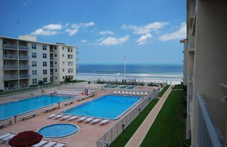 New Smyrna Beach condo photo - Beautiful pool and ocean view