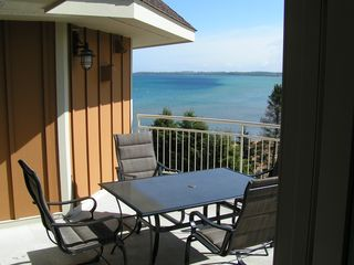 Traverse City condo photo - View from private balcony! Table and six chairs.