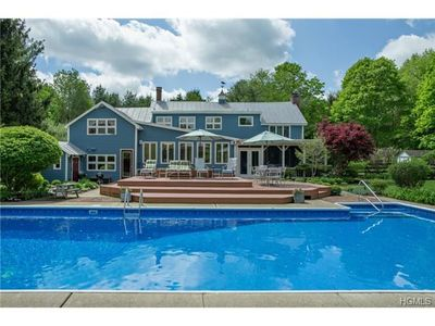 View from back yard in summer - large heated pool and spacious deck