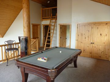 The Pool Table is in the loft. The kid's mini loft is in the background.