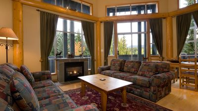 Living Area with Scenic Views, Vaulted Ceiling and Gas Fireplace