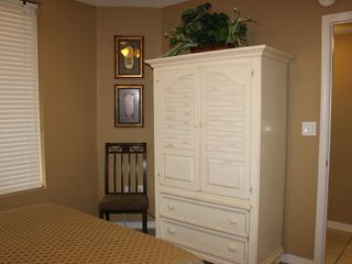 "Fort Walton Beach condo photo - Second bedroom with 25"" TV and DVD player in armoire"