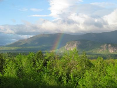 View from deck of rainbow over Echo Lake in the Mt Washington Valley