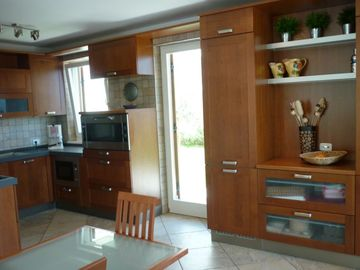 Kitchen for entertaining-oversized oven, microwave & dishwasher.