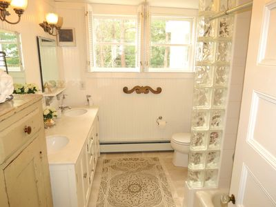 Second full bath, this one quite spacious with a double-sink vanity.