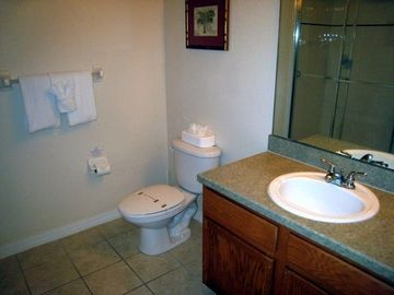 This bathroom is adjacent to 2 bedrooms. The 2nd bathroom is in the master suite