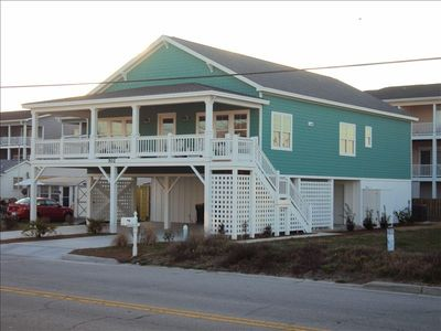 Kure Beach house rental - View of the house from the ocean access. Parking spaces in carport for five cars