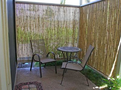 Shady rear patio offers privacy off back master bedroom.