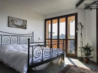 Montopoli Val d'Arno house photo - Master bedroom with king bed is sunny and open with wrap-around terraces.