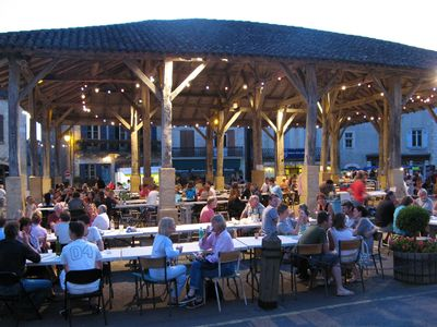 Go local and enjoy an evening meal at the summer night market in Belves.