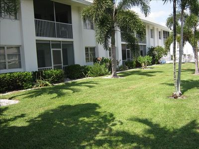 Lanai and Rear Lawn Viewed from Canal