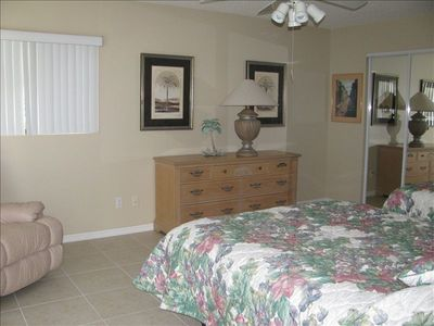Third bedroom, full bed and twin, recliner overlooking pool,  private bath.
