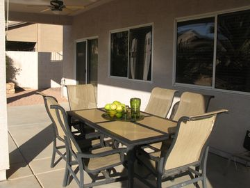 Patio complete with outdoor fans and blinds to make your comfort complete.