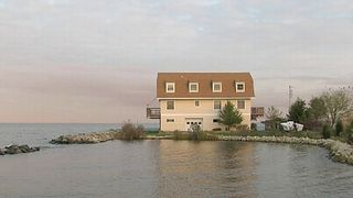 North Beach house photo - Surrounded by Water, with a boat landing for small craft.