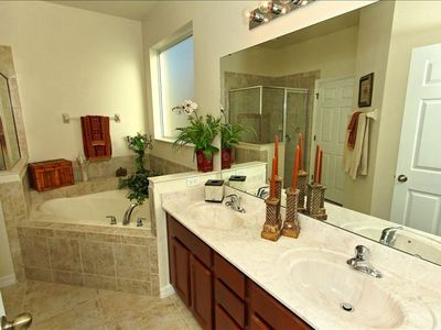 Beautifully appointed main floor master bathroom. Separate private commode.