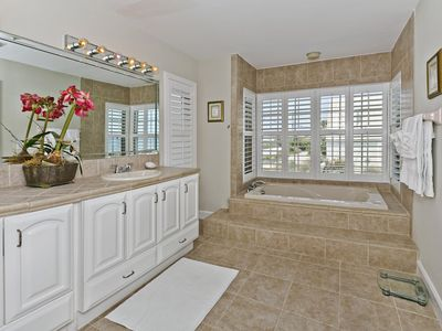 Master bath has separate shower and garden tub, two sinks and water closet