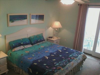 Adagio Ocean City condo rental - Master bedroom has a King bed, TV and access to the balcony