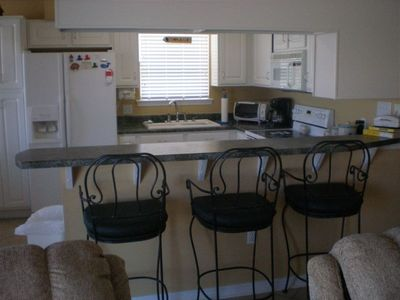 Fully equipped kitchen with counter and stools