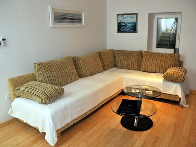 Living Room - Large Sofa, Coffee Table. Converts to 2 Single beds or 1 Double