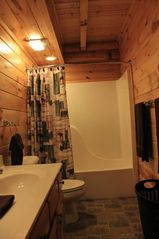 Gatlinburg cabin photo - Main Level Bathroom Double sink vanity, full tub, shower, toilet, and hamper.