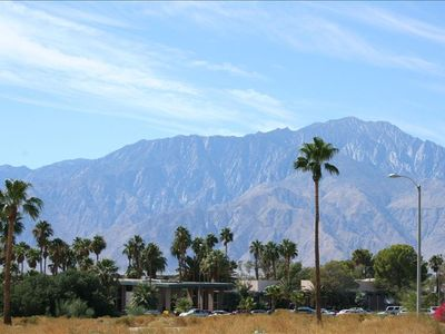 view of desert hot springs hotel and surrounding mountains standing next to home