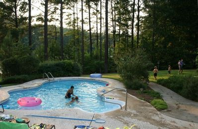 Relax by the pool while kids play in the yard.