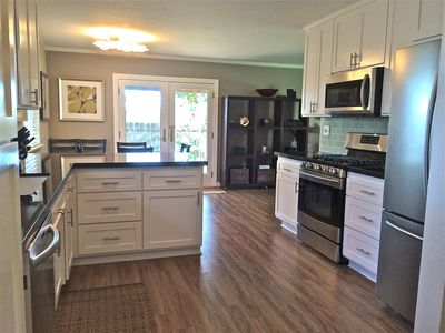 Completely remodeled kitchen with all new appliances, french doors to backyard