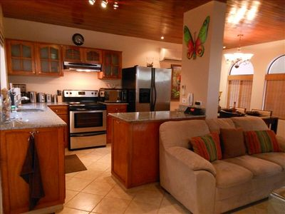 Fully appointed kitchen with stainless steel appliances and all amenities.