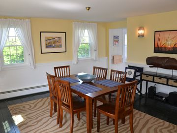 Dining area with game table and chairs in the rear corner