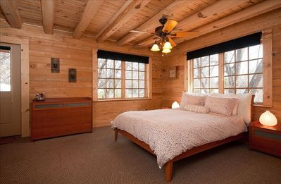 Master bedroom downstairs with queen size bed