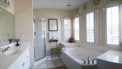 Master Bath has jetted tub and walk-in shower for 2 and separate his vanity.