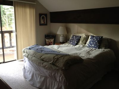 The master bedroom has a queen sized bed, private balcony and tv.