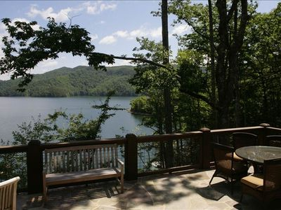 Open air main level 830 square ft patio w/ outdoor fireplace and lakefront views