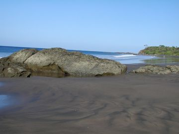 Walk the secluded colbalt sand beach