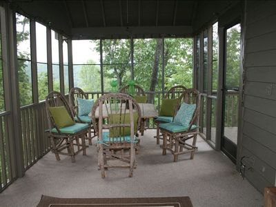 The screened porch offers outside dining option