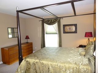 Jefferson farmhouse photo - Spacious bedroom with queen sized bed, view of pond, and adjoining den.