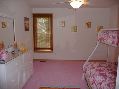 Pink room with view to rear of home and exterior stairs