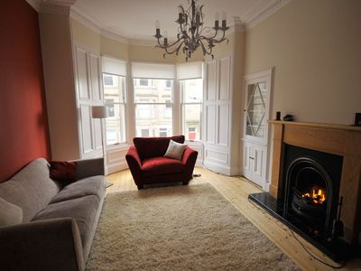 cosy lounge with open fire and bay window