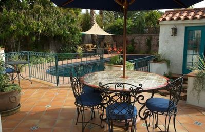 Gorgeous patio overlooking pool. Tropical garden with fruit trees and fountain.