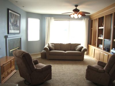 Oceanside condo rental - Living Room with sliding glass doors to Ocean View Patio.