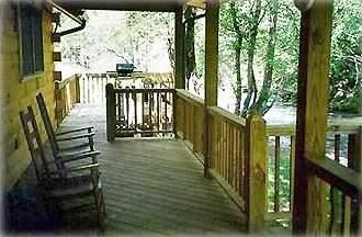 River Birch back porch ... toss a fishing line or relax in the rocking chairs ..