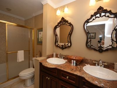 Blowing Rock house rental - One of two downstairs Granite/marble baths with double sinks and shower.