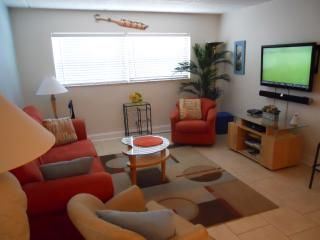 Cocoa Beach condo photo - The large comfortable living room features a 42 inch HDTV, sound bar and DVD